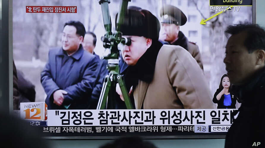 A man passes by a TV screen showing North Korean leader Kim Jong Un during a news program at Seoul Railway Station in Seoul, South Korea, Thursday, March 24, 2016.