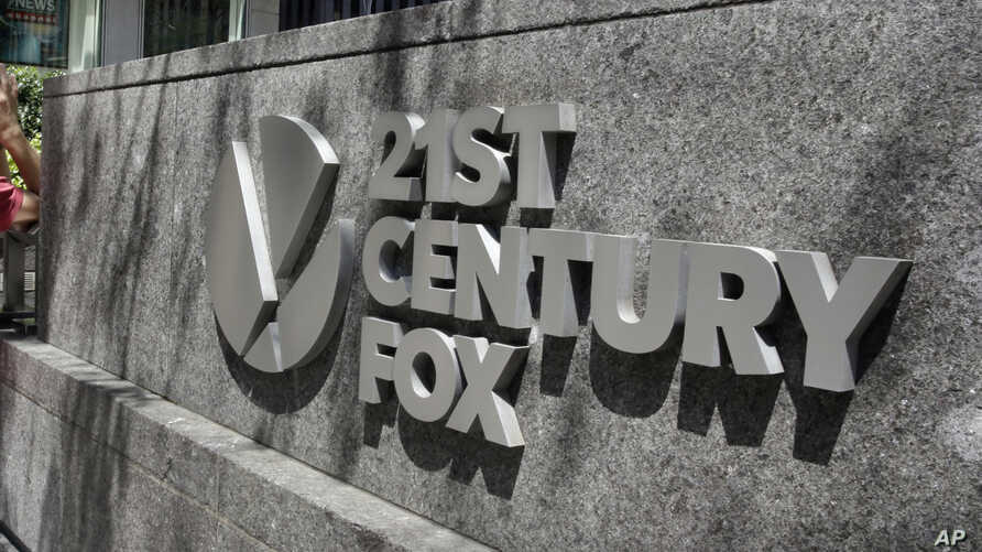 FILE - The 21st Century Fox sign is seen outside of the News Corporation headquarters building in New York.