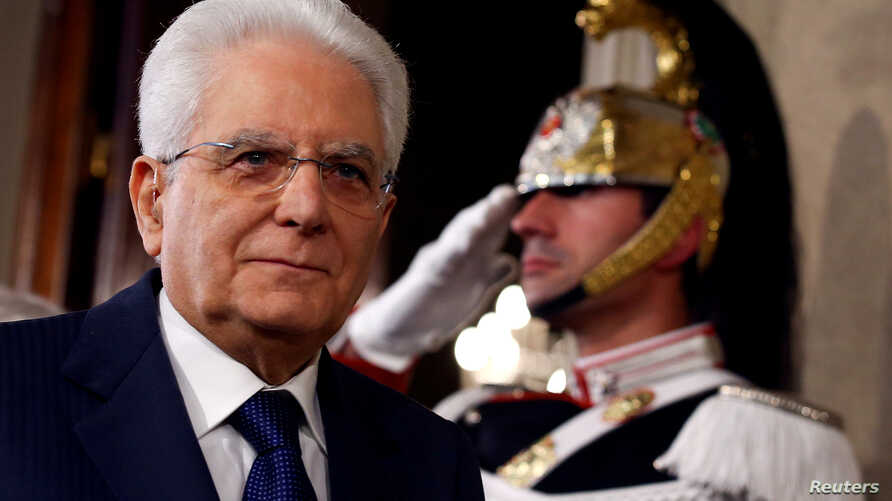 FILE - Italian President Sergio Mattarella speaks to reporters at the Quirinal Palace in Rome, April 5, 2018.