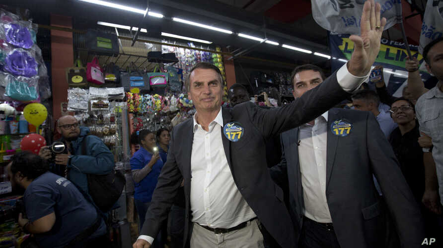 National Social Liberal Party presidential candidate Jair Bolsonaro greets people as he campaigns at Madureira market in Rio de Janeiro, Brazil, Aug. 27, 2018. Brazil will hold general elections on Oct. 7.