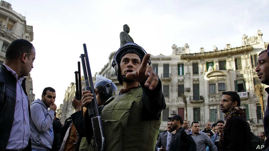 Egyptian security forces disperse people gathering to protest against a court order to release the two sons of ousted Egyptian President Hosni Mubarak in Talaat Harb Square downtown Cairo, Egypt, Jan. 22, 2015.