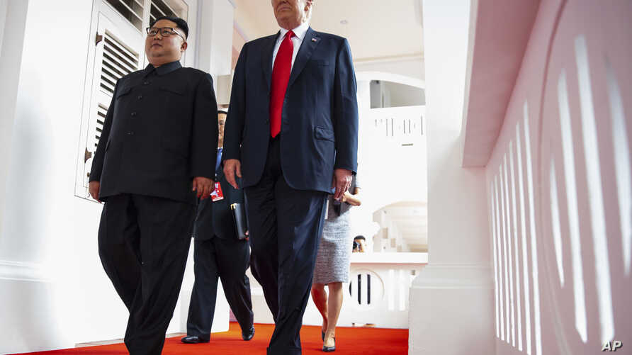 North Korea leader Kim Jong Un and U.S. President Donald Trump walk along the balconies at the Capella resort on Sentosa Island, June 12, 2018 in Singapore.