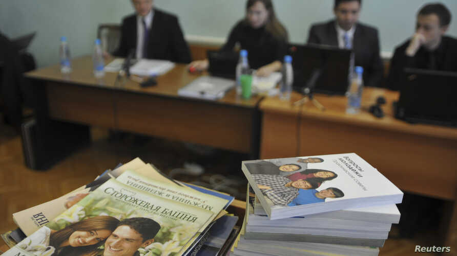 FILE - Stacks of booklets distributed by members of Jehovah's Witnesses are seen during the court session in the Siberian town of Gorno-Altaysk, Dec. 16, 2010.