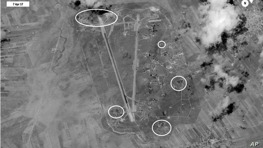FILE - This satellite image released by the U.S. Department of Defense shows a damage assessment image of Shayrat air base in Syria, following U.S. Tomahawk Land Attack Missile strikes on April 7, 2017.