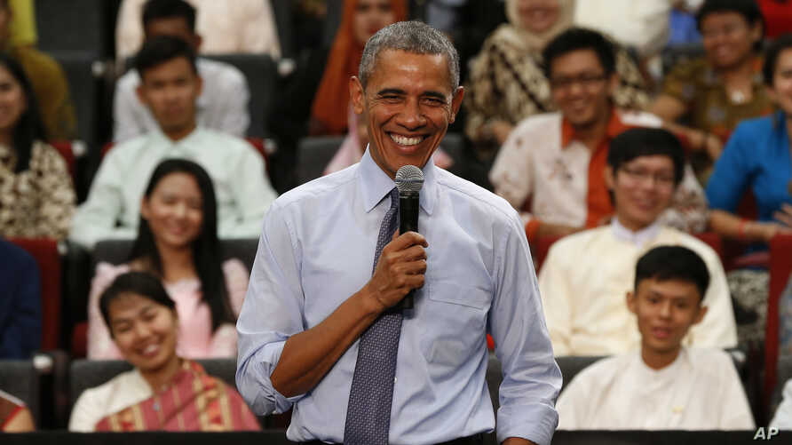 U.S. President Barack Obama smiles as he takes questions from the floor at the Young Southeast Asian Leaders Initiative (YSEALI) town hall meeting at Taylor's University in Kuala Lumpur, Malaysia, Nov. 20, 2015.
