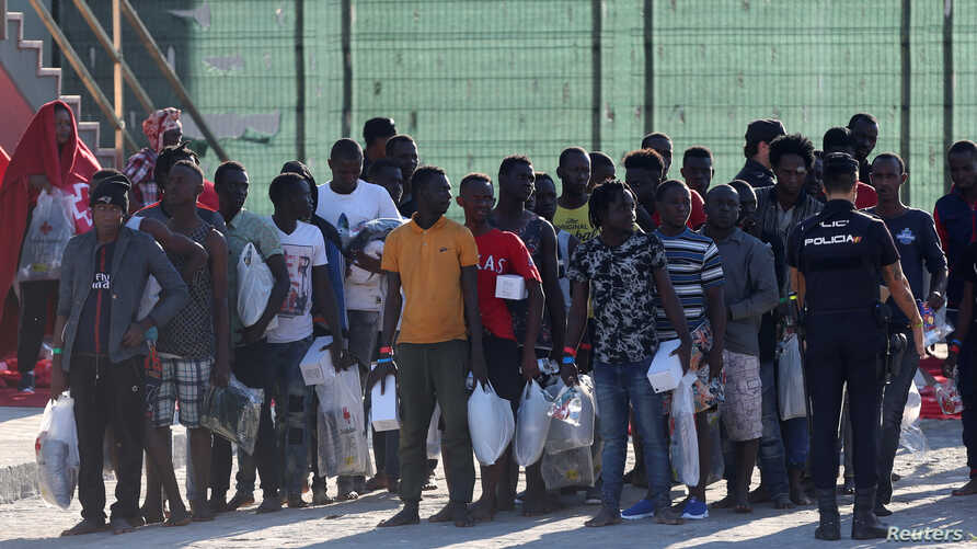Migrants are seen after disembarking a rescue boat at the port of Malaga, southern Spain, Sept. 23, 2018.