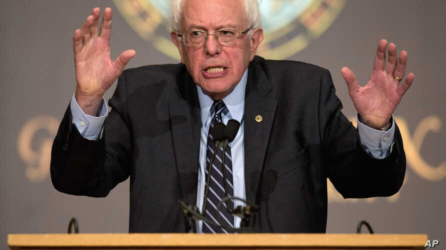 FILE - Democratic presidential candidate Sen. Bernie Sanders, I-Vt., speaks at Georgetown University in Washington. Sanders is a rolling out a plan to slow down the impact of climate change, vowing to cut U.S. carbon emissions, Nov. 19, 2015.