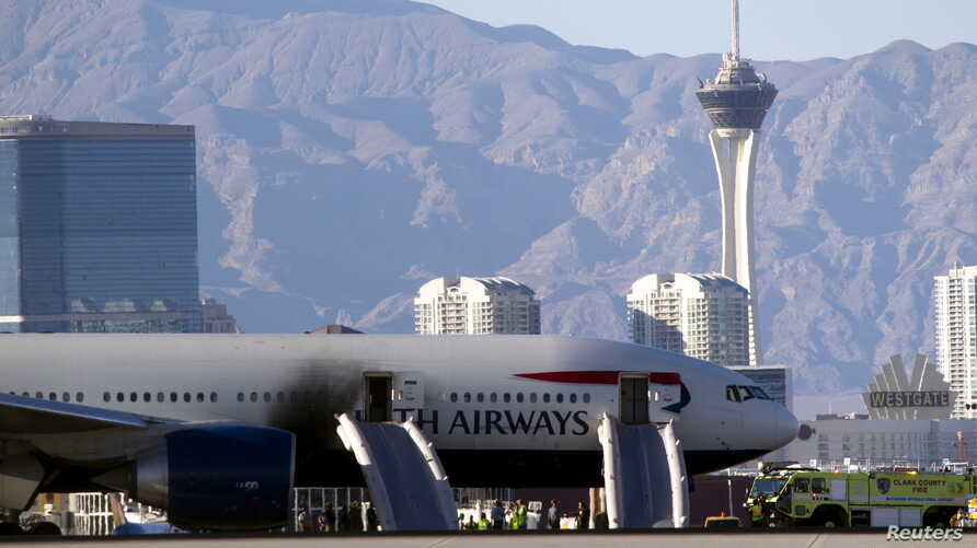 Soot darkens the door of a British Airways passenger jet after a fire at McCarran International Airport in Las Vegas, Nev., Sept. 8, 2015. Only minor injuries were reported among 172 people aboard.