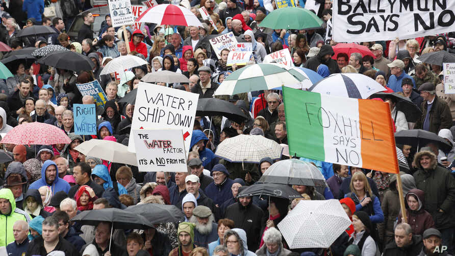 Thousands protesting Ireland's new tax on water make their way through the center of Dublin, Nov. 1, 2014