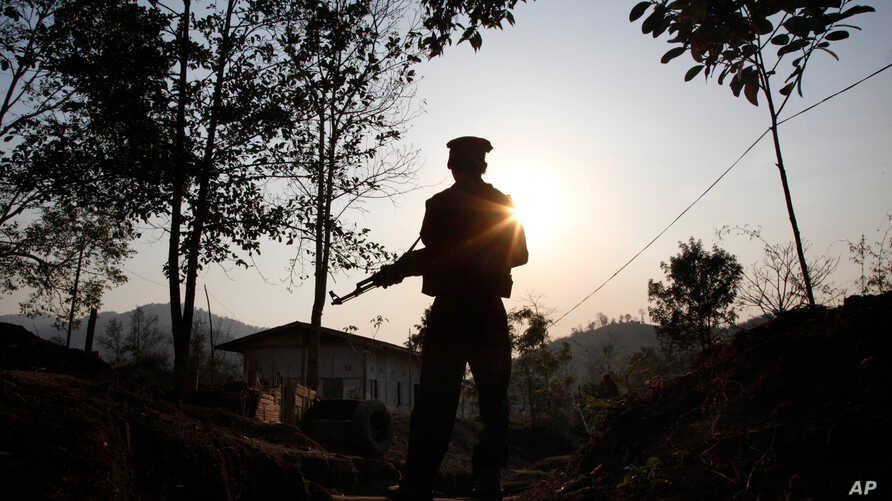 A Kachin Independence army rebel stands at frontline outpost facing no man's land in Lawa Yang, outside of Laiza, the armed group's headquarters in northern Kachin state, Myanmar, March 20, 2018. The war between Myanmar's government forces and the K