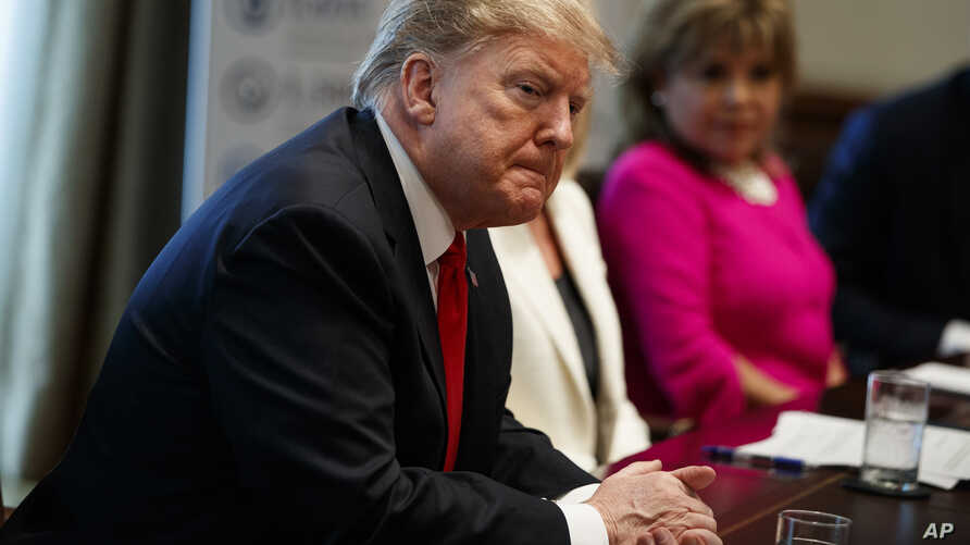 President Donald Trump listens during an event on human trafficking in the Cabinet Room of the White House, Feb. 1, 2019, in Washington.
