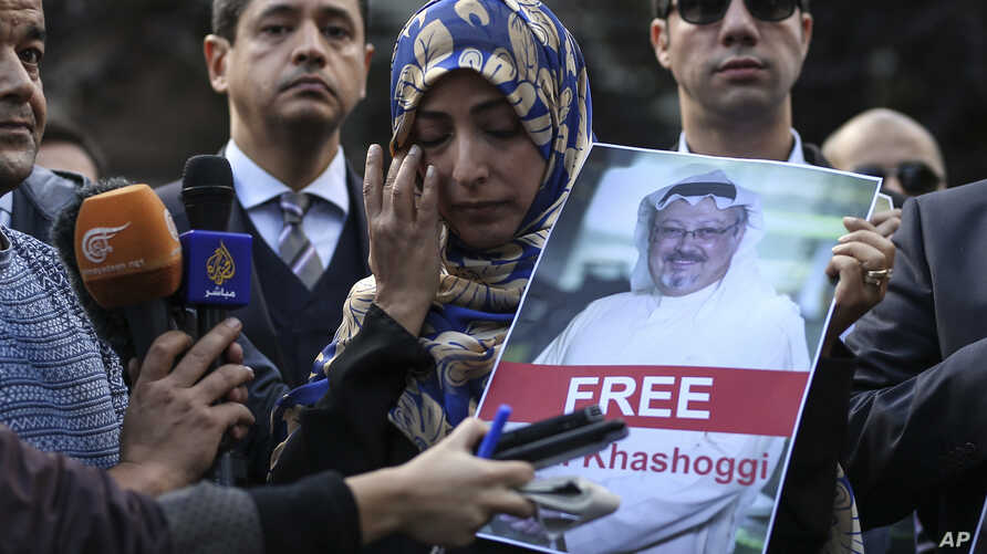 Holding a picture of missing Saudi writer Jamal Khashoggi, Tawakkol Karman, of Yemen the Nobel Peace Prize laureate for 2011, talks to members of the media near the Saudi Arabia consulate in Istanbul, Friday, Oct. 5, 2018. Khashoggi, a 59-year-old ve