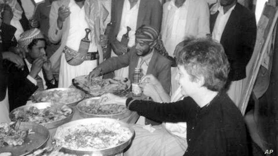 Enjoying a Yemeni meal with villagers in 1986