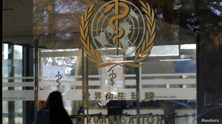 FILE - The World Health Organization's (WHO) logo is seen at the entrance of the UN agency's headquarters in Geneva, Switzerland.
