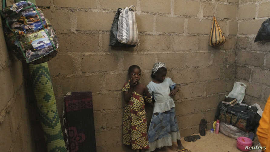 Children, who escaped Boko Haram attacks in both Michika and Cameroon, are seen inside an uncompleted house as they seek shelter in Adamawa, Nigeria, Jan. 31, 2015.
