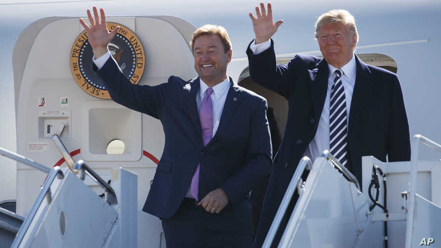 President Donald Trump arrives with Sen. Dean Heller, R-Nev., on Air Force One at Elko Regional Airport, Oct. 20, 2018, in Elko, Nev., for a campaign rally.