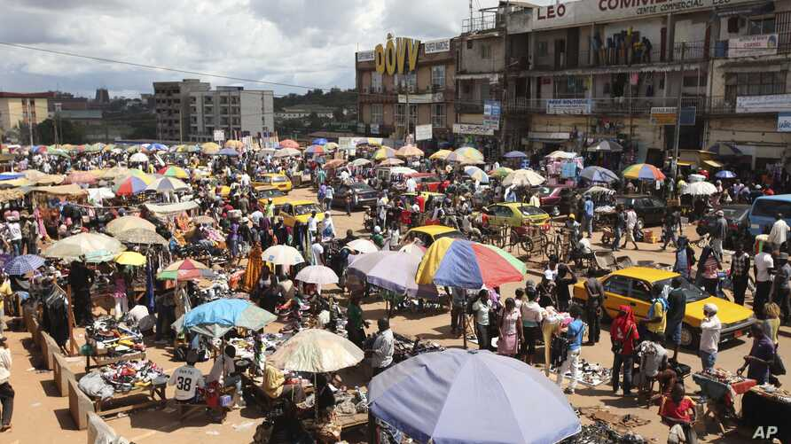 FILE - People shop at Mokolo market in Yaounde, Cameroon, Oct. 10. 2011.