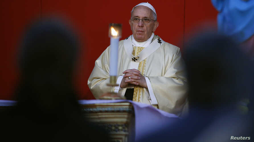 Pope Francis celebrates a mass on All Saints' Day at the Verano cemetery in Rome Nov. 1, 2014.