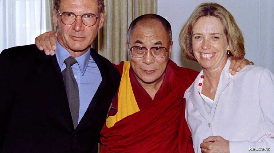 FILE - From left, actor Harrison Ford, the Dalai Lama of Tibet and Harrison's then-wife, Melissa Mathison, pose at a fundraiser for Tibet at the Regent Beverly Wilshire Hotel in Los Angeles, Aug. 1, 1996. Mathison died Nov. 4, 2015, at the age of 65.