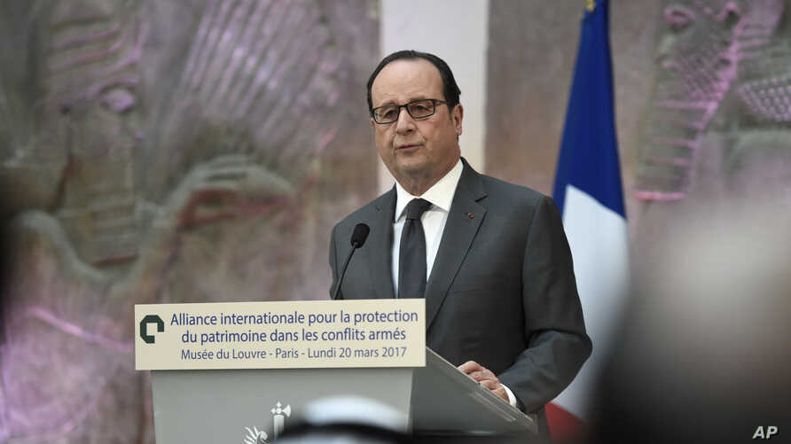 French President Francois Hollande delivers a speech as he participates in the International Donors' Conference for the Protection of Heritage in Armed Conflict at the Louvre Museum in Paris, France, Monday, March 20, 2017.