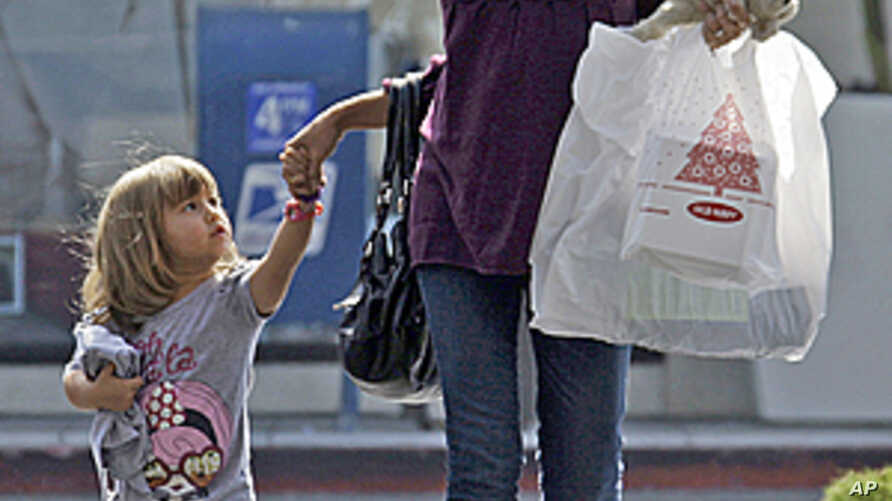 A woman and child leave a mall with purchases in Culver City, Calif., (File).