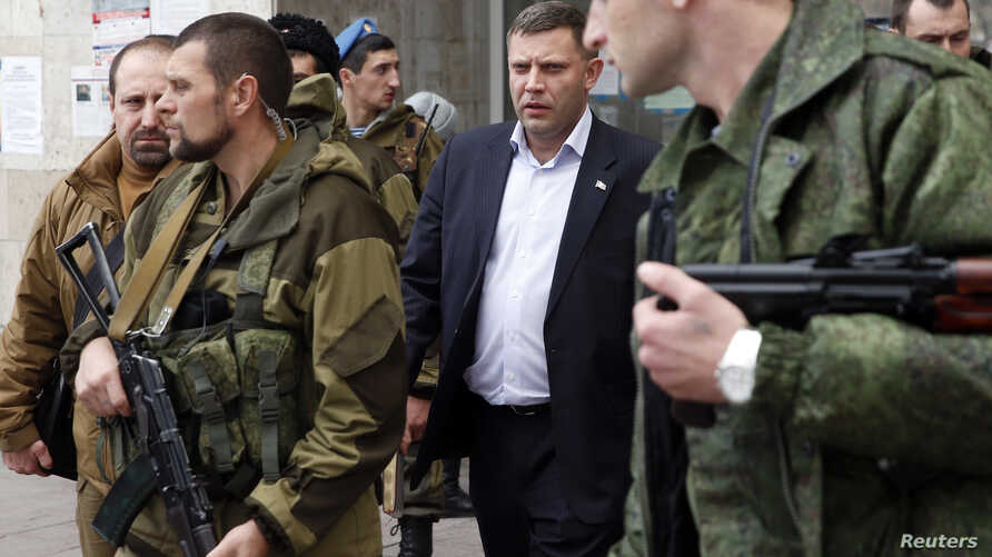 FILE - Head of the self-proclaimed Donetsk people's republic Alexander Zakharchenko (C) is seen surrounded by bodyguards in Donetsk, eastern Ukraine.