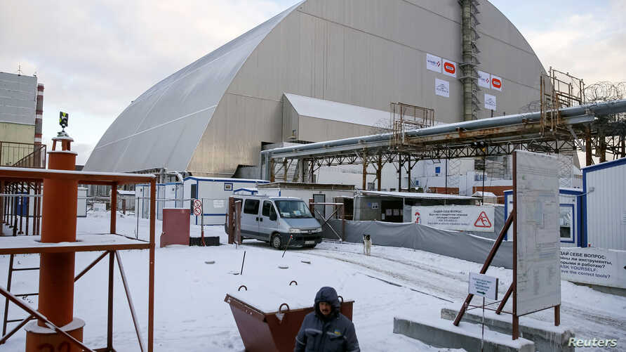 """A general view shows the """"New Safe Confinement"""" structure over the old sarcophagus covering the damaged fourth reactor at the Chernobyl nuclear power plant in Chernobyl, Ukraine, Nov. 29, 2016."""