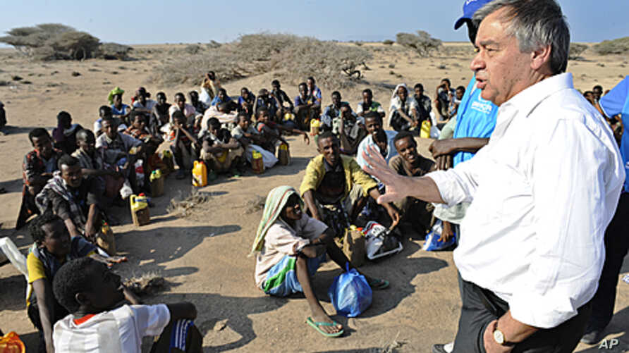 UN refugee agency chief Antonio Guterres (R) speaks to Ethiopian illegal immigrants from the Oromo region waiting for smugglers' boats to cross the Gulf of Aden into Yemen. Each year tens of thousands of Ethiopians and Somalis make the perilous cross