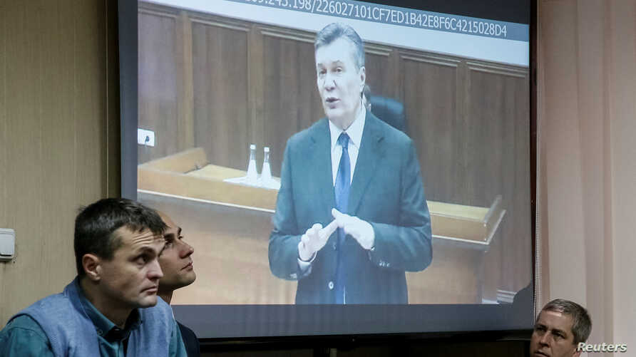 Viktor Yanukovych gives evidence via a video link seen on the courtroom screen in Kyiv, Ukraine, Monday, Nov. 28, 2016. The former president testified during the trial of former police officers suspected of killing protesters during the Maidan street...