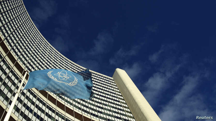 FILE - The flag of the International Atomic Energy Agency (IAEA) flies in front of its headquarters in Vienna, Austria.
