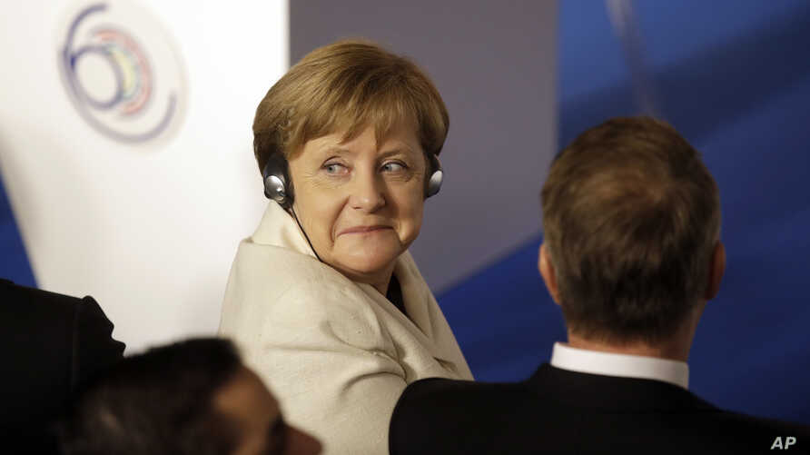 German Chancellor Angela Merkel listens to the opening address during an EU summit meeting at the Orazi and Curiazi Hall in the Palazzo dei Conservatori in Rome, March 25, 2017.