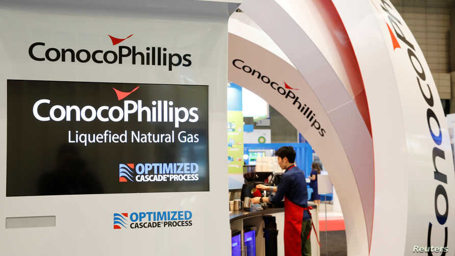 Logos of ConocoPhillips are seen in its booth at Gastech, the world's biggest expo for the gas industry, in Chiba, Japan, April 4, 2017.