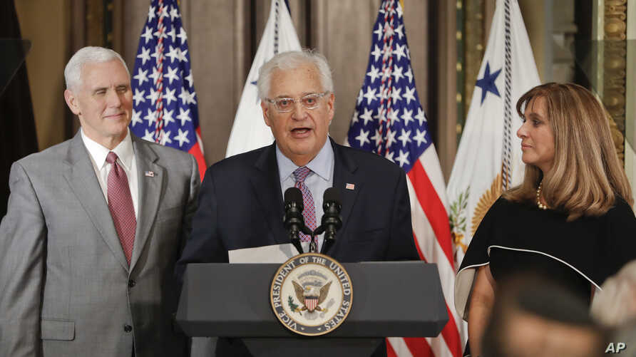 U.S. Ambassador to Israel David M. Friedman, center, accompanied by his wife Tammy, right, speaks after Vice President Mike Pence  administered the oath of office, March 29, 2017, in the Eisenhower Executive Office Building in Washington.
