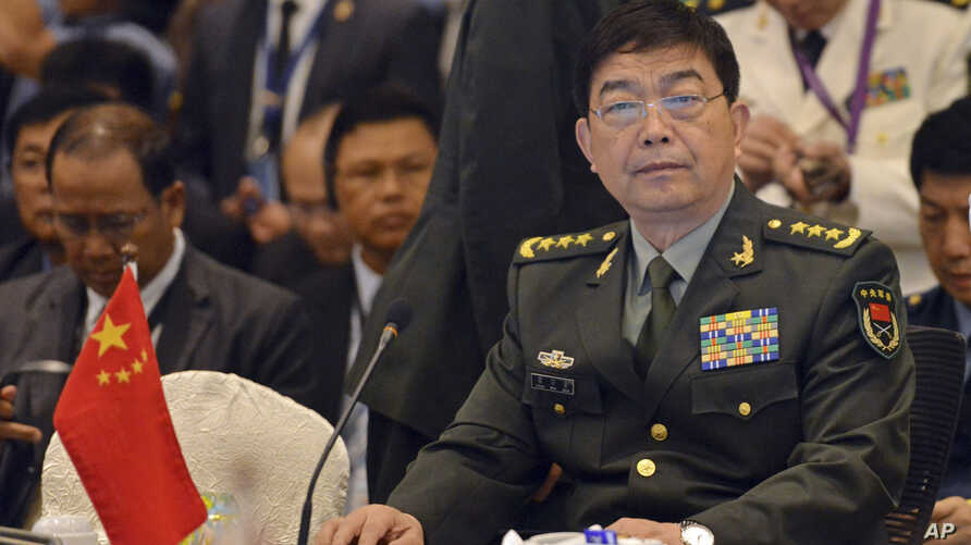 FILE - China's Defense Minister Chang Wanquan, right, sits before the start of an Association of Southeast Asian Nations (ASEAN) Defense Ministers' meeting in Kuala Lumpur, Malaysia, Nov. 4, 2015.