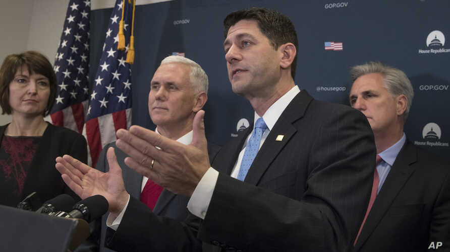 House Speaker Paul Ryan (foreground) is joined by fellow Republicans, including Vice President-elect Mike Pence (second left), at a news conference following a closed-door meeting at the Capitol in Washington, Jan. 4, 2017.