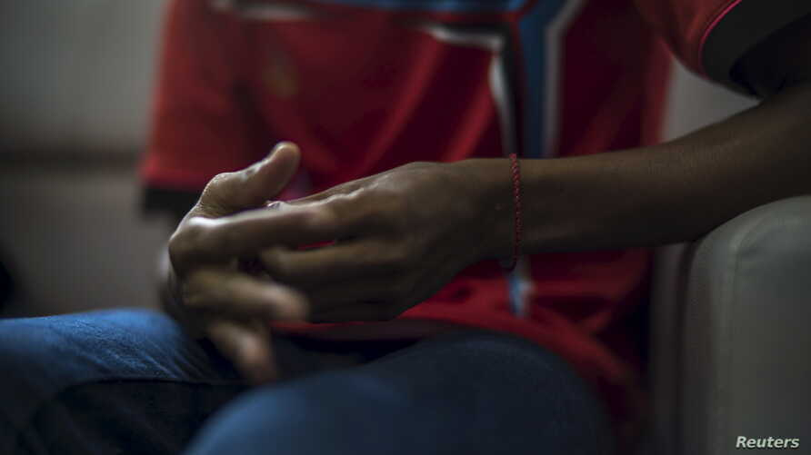 FILE - The hands of a Rohingya victim of trafficking are seen as he listens to questions during an interview with the Thomson Reuters Foundation at a temporary shelter in Hat Yai, Songkla, Thailand.