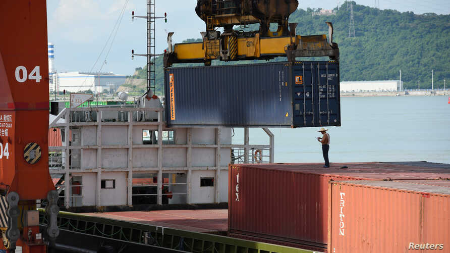 FILE - Shipping containers are seen on a cargo vessel at the Dachan Bay Terminals in Shenzhen, Guangdong province, China July 12, 2018.