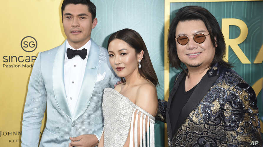 "Henry Golding, from left, Constance Wu and executive producer/author Kevin Kwon arrive at the premiere of ""Crazy Rich Asians"" at the TCL Chinese Theatre, Aug. 7, 2018, in Los Angeles."