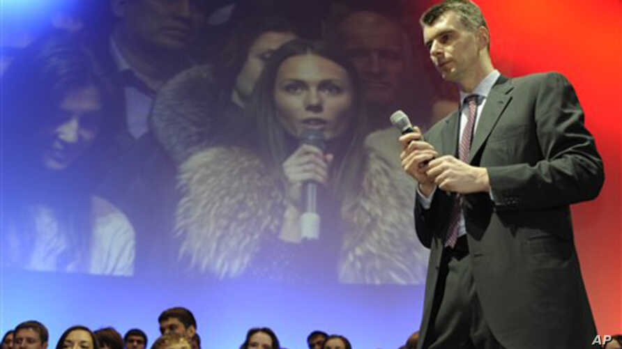 Russian billionaire and presidential candidate Mikhail Prokhorov meets with young voters in the Siberian city of Novosibirsk, Jan. 27, 2012.