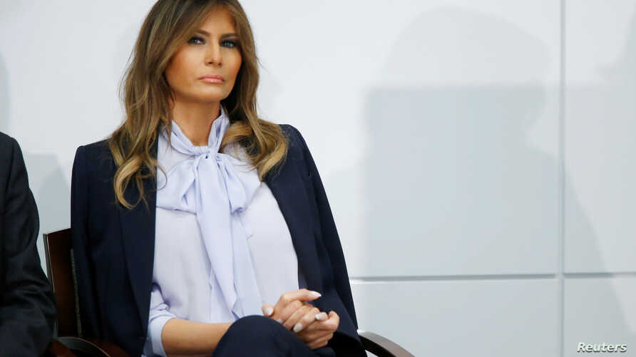 """U.S. first lady Melania Trump waits to speak at the Federal Partners in Bullying Prevention (FPBP) Cyberbullying Prevention Summit on """"the positive and negative effects of social media on youth"""" in Rockville, Maryland, Aug. 20, 2018."""