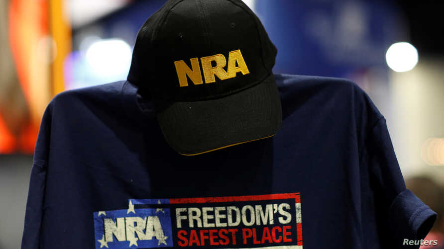 A cap and shirt are displayed at the booth for the National Rifle Association (NRA) at the Conservative Political Action Conference (CPAC) at National Harbor, Maryland, U.S., Feb. 23, 2018.