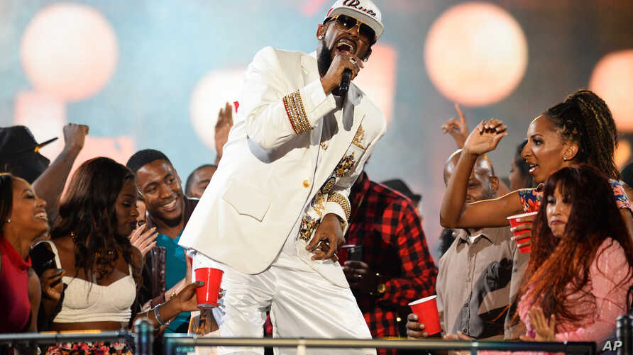R. Kelly performs during the 2015 Soul Train Awards at the Orleans Arena on Nov. 6, 2015, in Las Vegas.