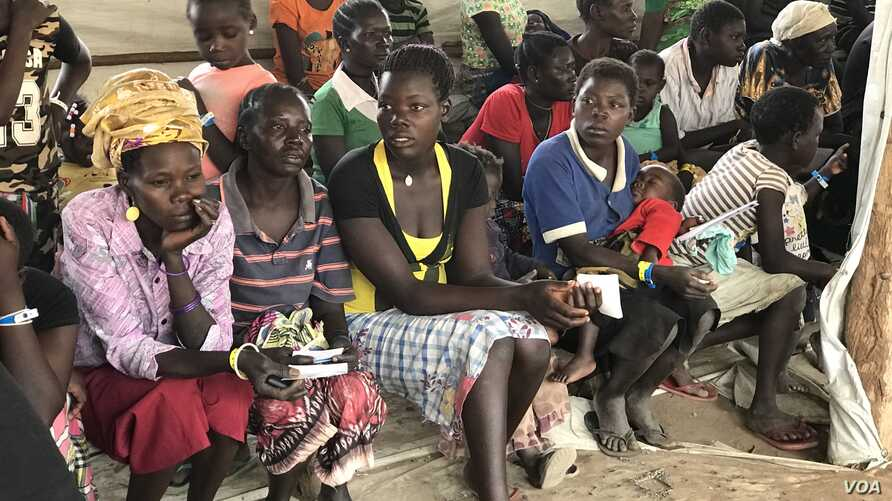New refugee arrivals from South Sudan wait to register at the Imvempi reception center in Arua district, Uganda, Jan. 30, 2018. (H. Athumani/VOA)