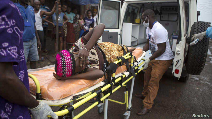 A pregnant woman suspected of contracting Ebola is lifted by stretcher into an ambulance in Freetown, Sierra Leone Sept. 19, 2014 in a handout photo provided by UNICEF.