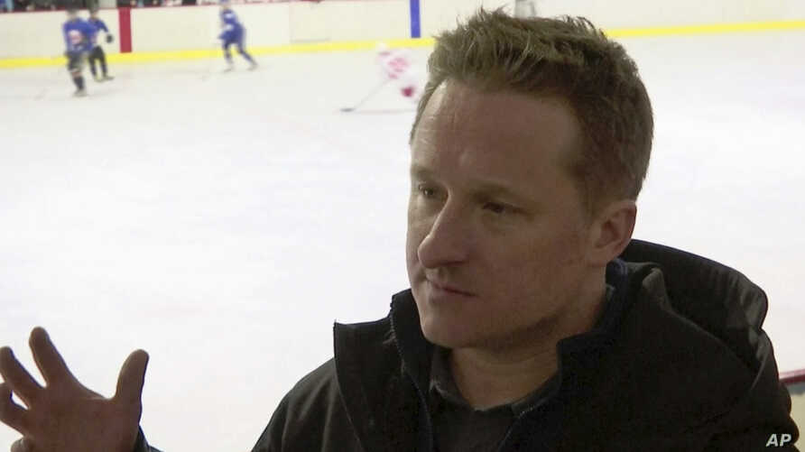 In this image made from video taken on March 11, 2016, entrepreneur Michael Spavor speaks during a friendly hockey match between visiting foreigners and North Korean players in Pyongyang, North Korea.