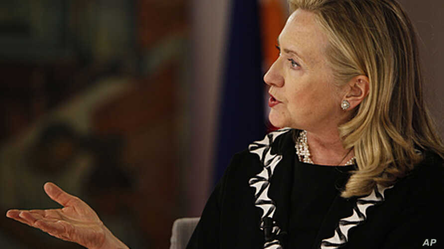 U.S. Secretary of State Hillary Rodham Clinton gestures during her townhall meeting and interview with Filipino scholars in Manila, Nov. 16, 2011.