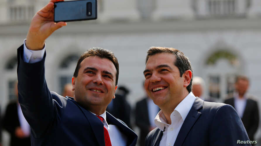 North Macedonia's Prime Minister Zoran Zaev, left, and Greek Prime Minister Alexis Tsipras attend a welcoming ceremony in Skopje, North Macedonia April 2, 2019.