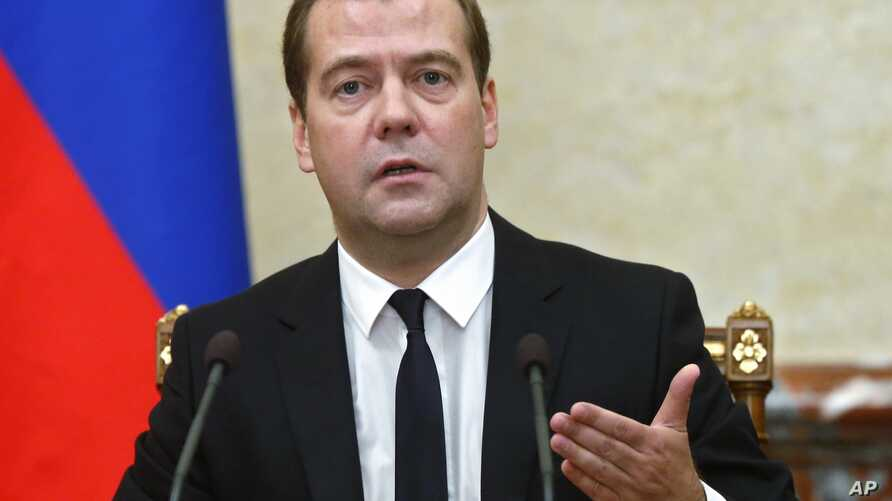 Russian Premier Dmitry Medvedev announces sanctions at the Cabinet meeting in Moscow on Thursday, Aug. 7, 2014.The Russian government has banned all imports of meat, fish, milk and milk products and fruit and vegetables from the United States, the Eu
