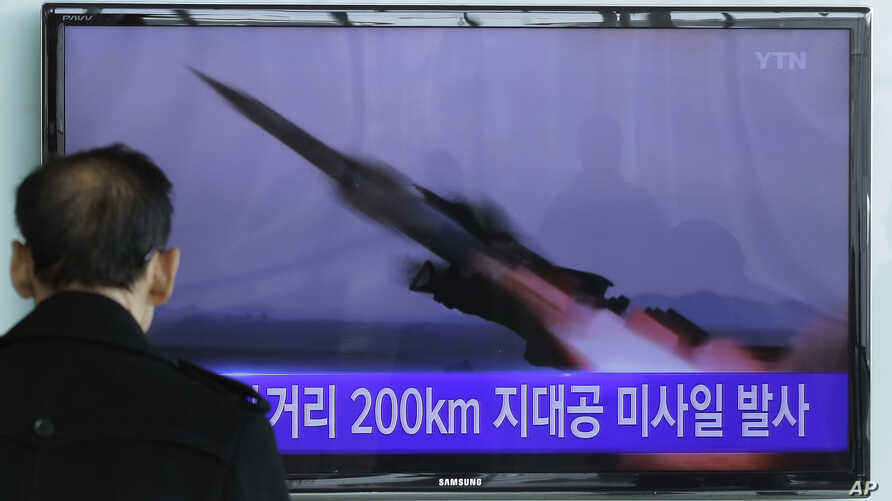 A South Korean man watches a TV news program showing the file footage of the missile launch conducted by North Korea, at Seoul Railway Station in Seoul, South Korea, March 13, 2015.