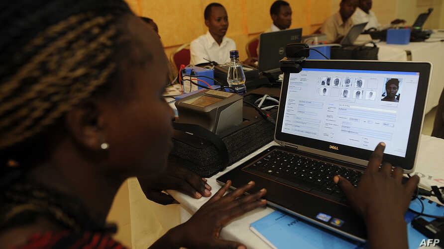 An election official demonstrates the use of newly acquired biometric voter registration technology in Nairobi November 6, 2012.